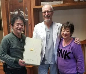 Chiropractor Anchorage AK William Ross and contest winner Janet Samson-Umoto and Brian Umoto