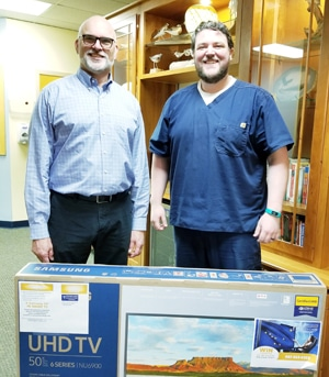 Winner of 50 Inch TV at Excellence In Health Chiropractic & Rehab Clinic